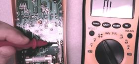 How do you test a capacitor with a multimeter?